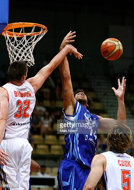 Dean Brebner of the Taipans and Matthew Knight of the Spirit rebound during the round 21 NBL match between the Sydney Spirit and the Cairns Taipans...