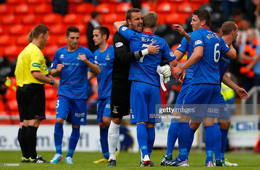 Dean Brill (C) of Inverness Caledonian Thistle celebrates with William McKay at full time of the Scottish Premier League match between Dundee United and Inverness Caledonian Thistle at Tannadice Park on August 10, 2013 in Dundee, Scotland