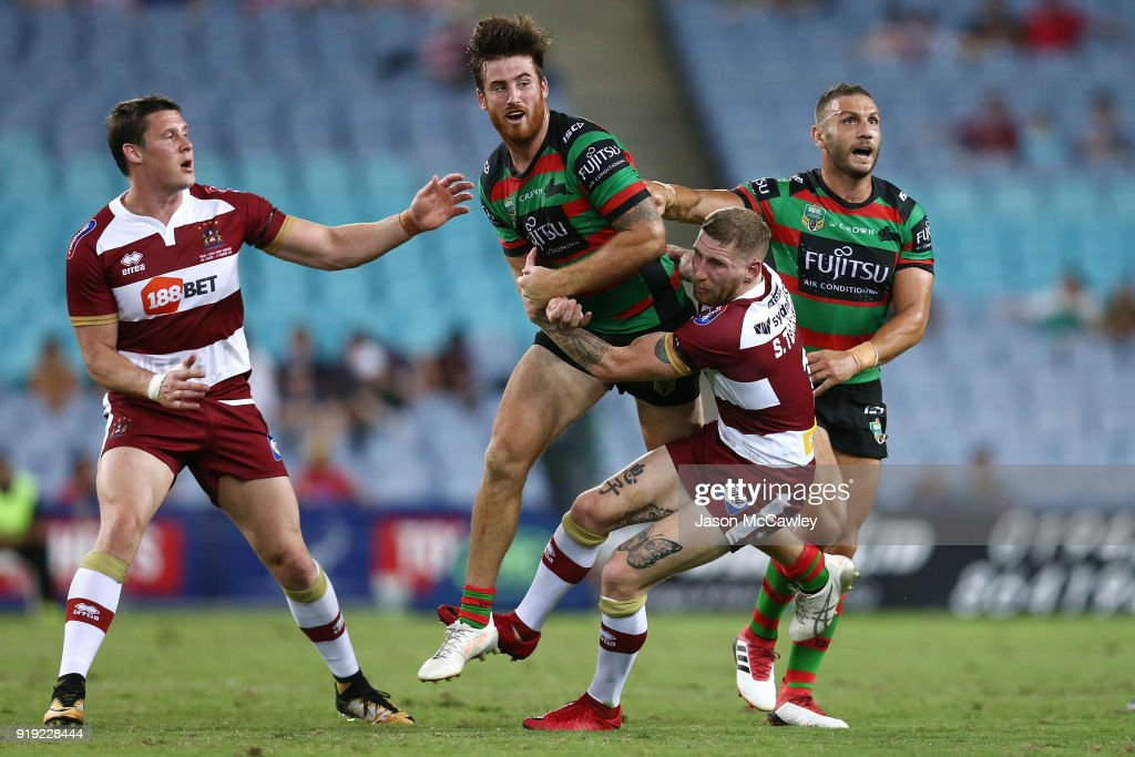 Dean Britt of the Rabbitohs is tackled by Sam Tomkins of Wigan during the NRL trial match between the South Sydney Rabbitohs and Wigan at ANZ Stadium on February 17, 2018 in Sydney, Australia.