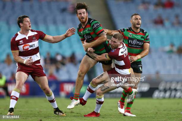 Dean Britt of the Rabbitohs is tackled by Sam Tomkins of Wigan during the NRL trial match between the South Sydney Rabbitohs and Wigan at ANZ Stadium...