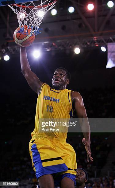 Dean Browne of Barbados goes up for a slamdunk during the 5th place playoff basketball match between Scotland and Barbados at the Multi Purpose Venue...