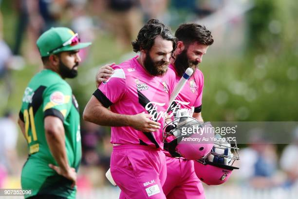 Dean Brownlie and Anton Devcich of the Knights walks off the field after winning the Super Smash Grand Final match between the Knights and the Stags...