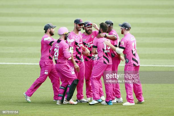 Dean Brownlie of the Knights celebrates with teammates for the wicket of George Worker of the Stags during the Super Smash Grand Final match between...