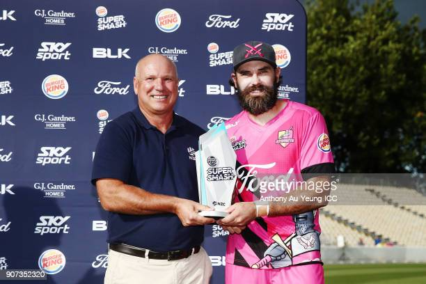 Dean Brownlie of the Knights is presented with the Burger King Super Smash Trophy after winning the Super Smash Grand Final match between the Knights...