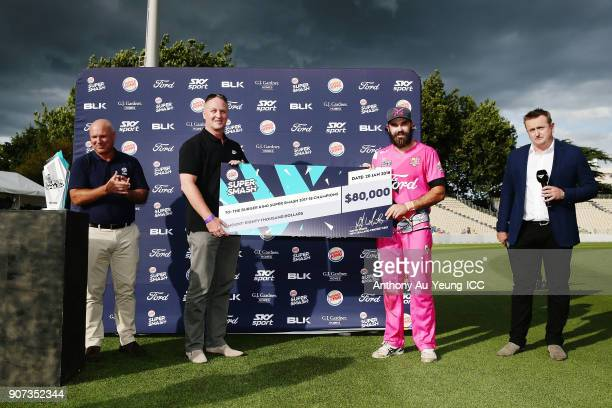 Dean Brownlie of the Knights is presented with the winning cheque after winning the Super Smash Grand Final match between the Knights and the Stags...