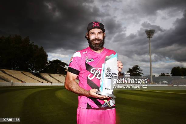 Dean Brownlie of the Knights poses for a photo with the Burger King Super Smash Trophy after winning the Super Smash Grand Final match between the...