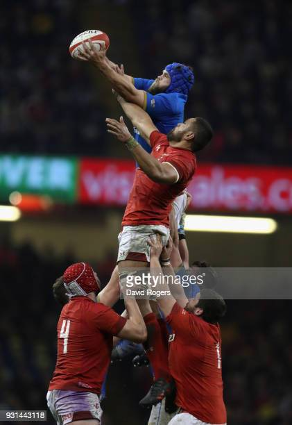 Dean Budd of Italy outjumps Taulupe Faletau in the lineout during the NatWest Six Nations match between Wales and Italy at the Principality Stadium...