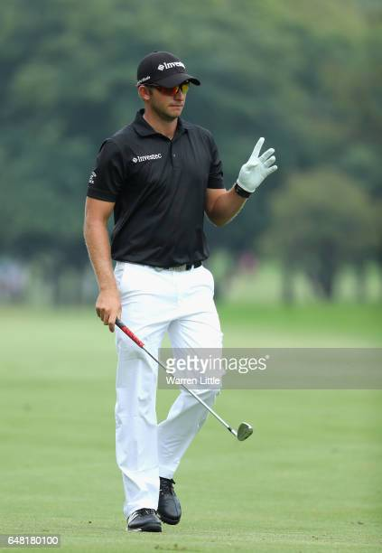 Dean Burmester of South Africa acknowledges the crowd on the fourth hole during the final round of the Tshwane Open at Pretoria Country Club on March...