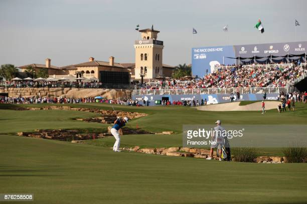 Dean Burmester of South Africa plays his fourth shot on the 18th hole during the final round of the DP World Tour Championship at Jumeirah Golf...