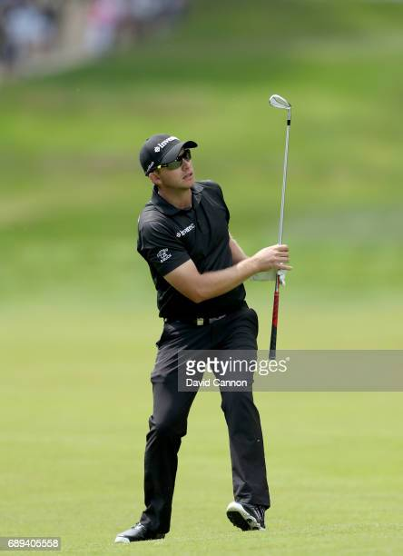 Dean Burmester of South Africa plays his second shot at the par 5 17th hole during the final round of the 2017 BMW PGA Championship on the West...