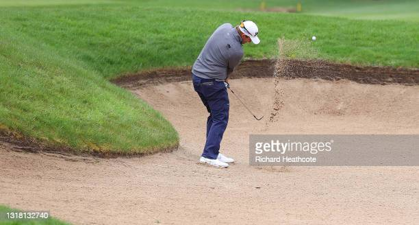 Dean Burmester of South Africa plays his second shot from a fairway bunker on the third hole during the final round of The Betfred British Masters...