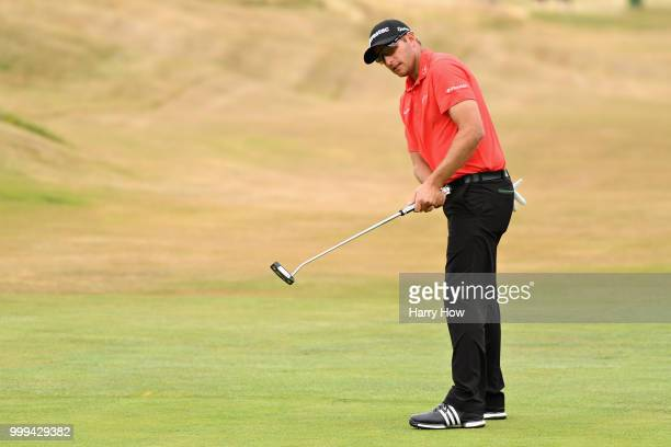 Dean Burmester of South Africa reacts to his par putt on hole one during day four of the Aberdeen Standard Investments Scottish Open at Gullane Golf...