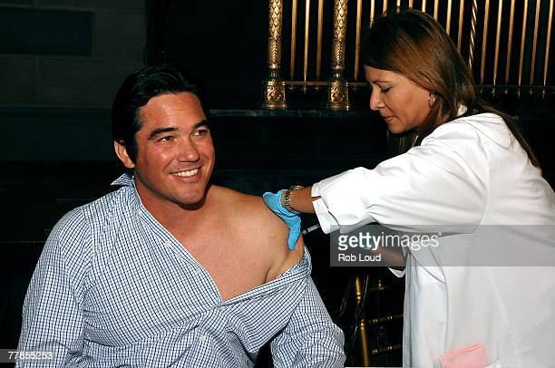Dean Cain receives a flu shot at the National Influenza Initiative launch at Gotham Hall on November 12 2007 in New York City