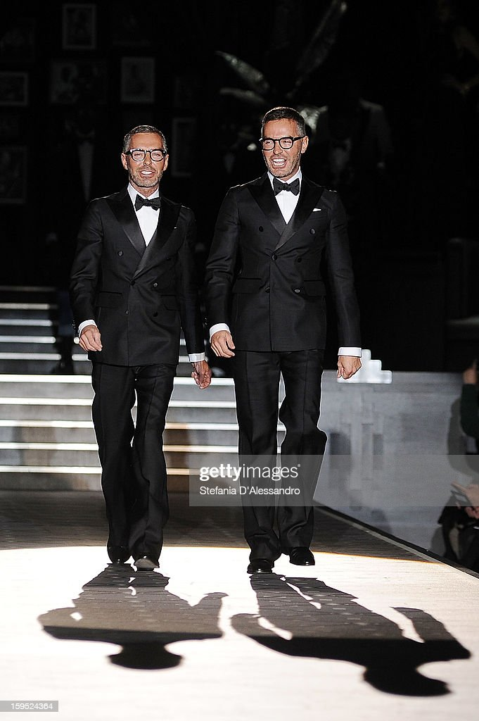Dean Caten and Dan Caten walk the runway after the DSquared2 show as part of Milan Fashion Week Menswear Autumn/Winter 2013 on January 15, 2013 in Milan, Italy.