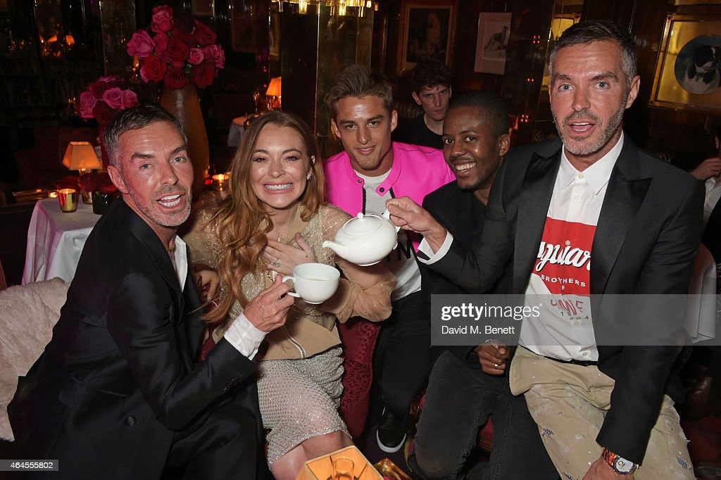 Dean Caten, Lindsay Lohan, guest, Vas J Morgan and Dan Caten attend the Mert & Marcus House of Love party for Madonna at Annabel's on February 26, 2015 in London, England.