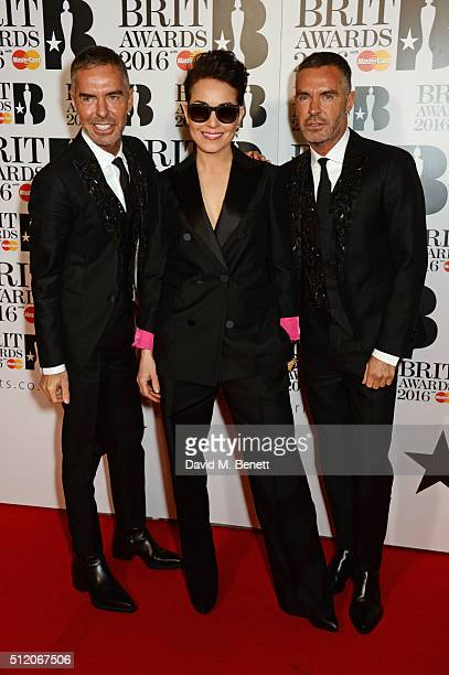 Dean Caten Noomi Rapace and Dan Caten arrive at the BRIT Awards 2016 at The O2 Arena on February 24 2016 in London England