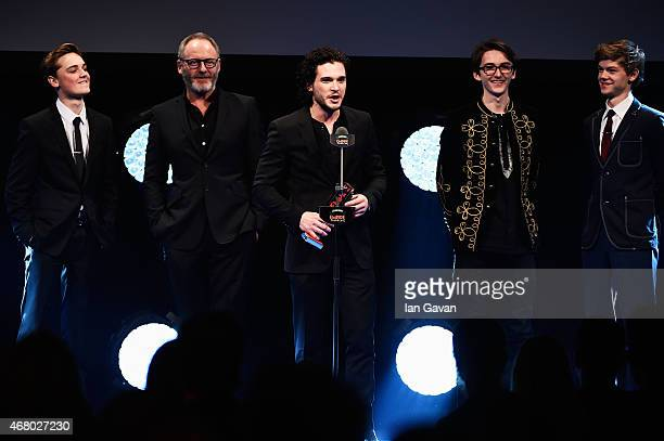 Dean CharlesChapman Liam Cunningham Kit Harington Isaac Kempstead and Thomas BrodieSangster collect the Empire Hero Award for 'Game of Thrones' on...