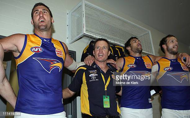 Dean Cox and John Worsfold of the Eagles join in the singing the club song to celebrate after winning the round two AFL match between Port Adelaide...