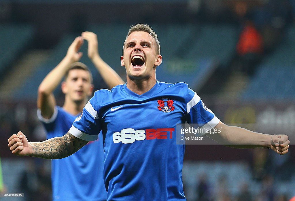 Dean Cox of Leyton Orient celebrates after the final whistle after his side won the Capital One Cup second round match between Aston Villa and Leyton Orient at Villa Park on August 27, 2014 in Birmingham, England.