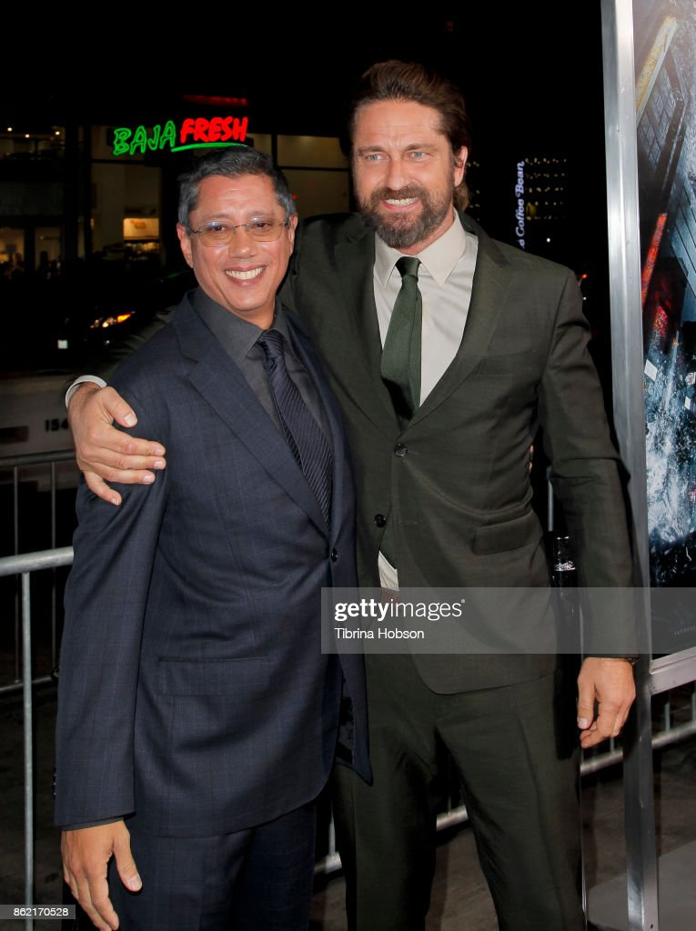 Dean Devlin and Gerard Butler attend the premiere of Warner Bros. Pictures 'Geostorm' at TCL Chinese Theatre on October 16, 2017 in Hollywood, California.