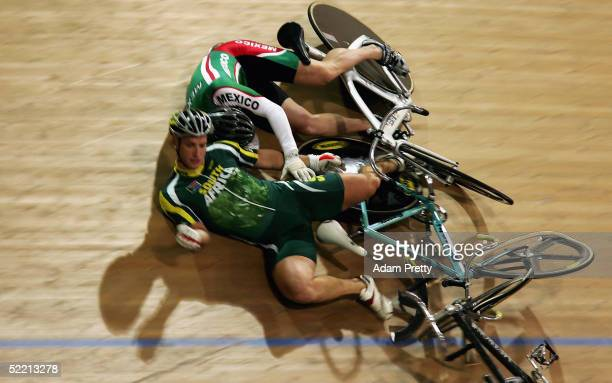 Dean Edwards of South Africa and Angel Martorell of Mexico crash out in the mens Keiren during day one of the UCI Track Cycling World Cup at the Dunc...
