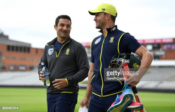 Dean Elgar and Heino Kuhn of South Africa walk to the nets during a nets session at Old Trafford on August 2 2017 in Manchester England