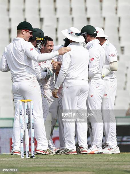Dean Elgar, bowler of South Africa celebrating after taking wicket Indian team player W Saha during the test match been played at PCA Stadium on...