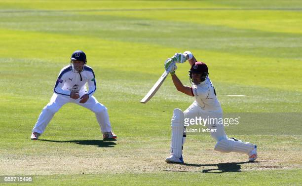 Dean Elgar of Somerset hits out past George Bailey of Hampshire during Day One of The Specsavers County Championship Division One match between...