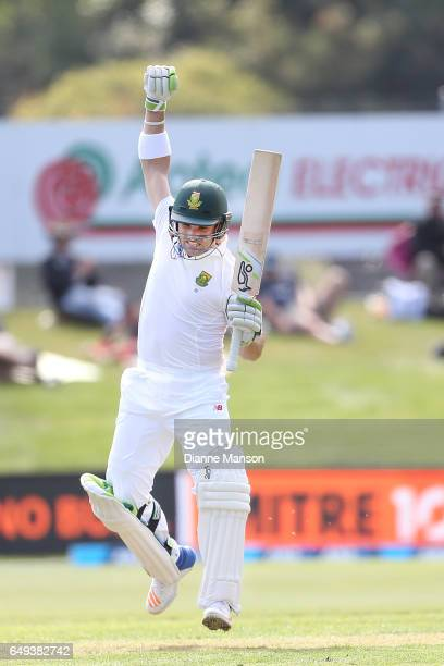 Dean Elgar of South Africa celebrates his century during day one of the First Test match between New Zealand and South Africa at University Oval on...