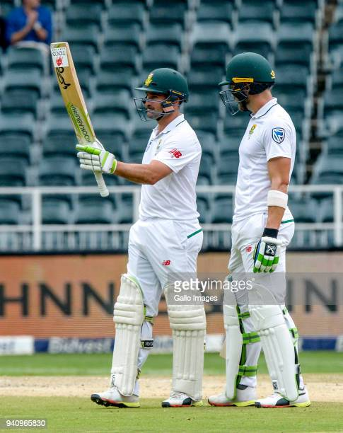Dean Elgar of South Africa stands with teammate Faf du Plessis as he celebrates his half century during day 4 of the 4th Sunfoil Test match between...