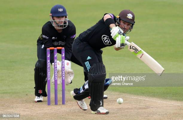 Dean Elgar of Surrey bats as Wicketkeeper Gareth Roderick of Gloucestershire looks on during the Royal London OneDay Cup match between Surrey and...