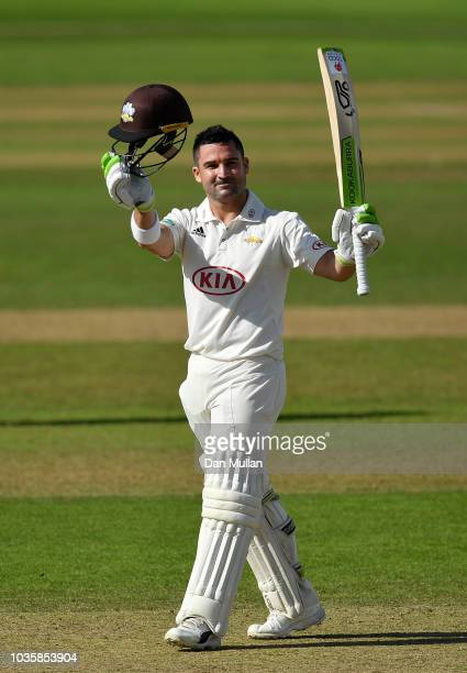 Dean Elgar of Surrey celebrates reaching his century during day two of the Specsavers County Championship Division One match between Somerset and...
