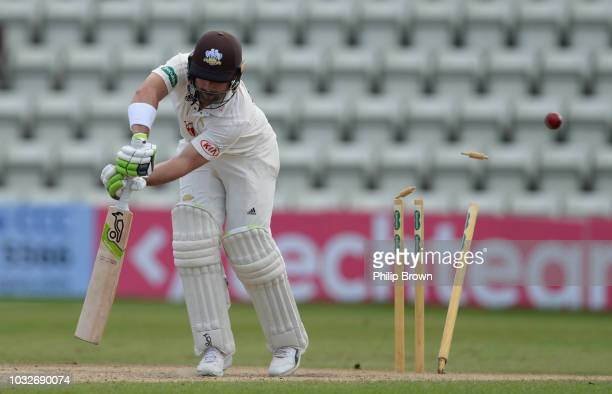 Dean Elgar of Surrey is bowled during the Specsavers County Championship Division One match between Worcestershire and Surrey at County Ground on...