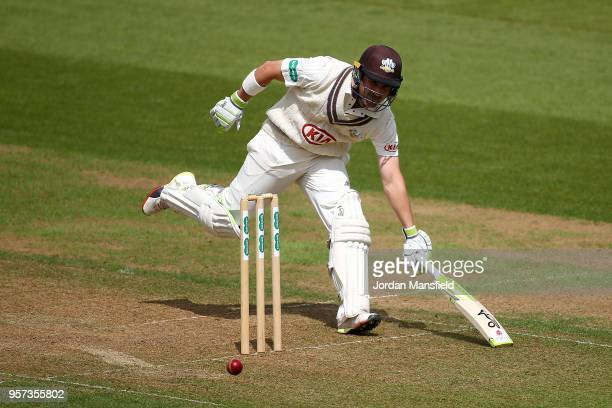 Dean Elgar of Surrey lunges to make his ground during day one of the Specsavers County Championship Division One match between Surrey and Yorkshire...