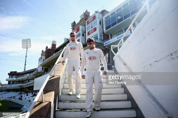Dean Elgar of Surrey makes his way out onto the field to begin day four of the Specsavers County Championship Division One match between Surrey and...