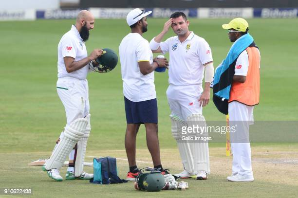 Dean Elgar of the Proteas gets attention after been hit on the head during day 3 of the 3rd Sunfoil Test match between South Africa and India at...