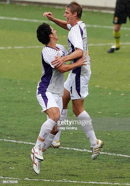 Dean Evans and Brent Griffiths of the Glory celebrate after Griffiths scored during the round 23 National Youth League match between Sydney FC and...