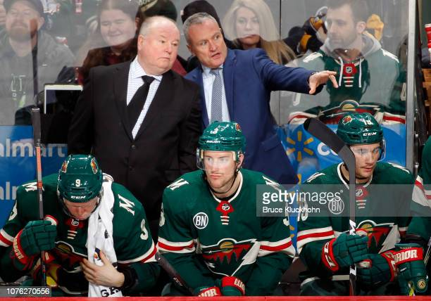 Dean Evason of the Minnesota Wild chats with Bruce Boudreau of the Minnesota Wild during a game with the Pittsburgh Penguins at Xcel Energy Center on...