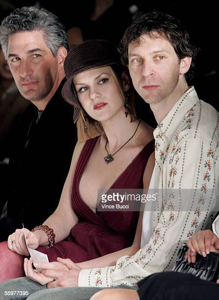 Dean Factor of Smashbox with actress Sara Rue and husband Mischa Livingstone in the front row at the Saja Spring 2006 show during MercedesBenz...