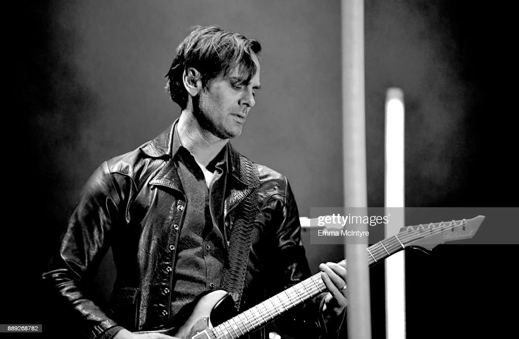 Dean Fertita of Queens of the Stone Age performs onstage during KROQ... News Photo   Getty Images
