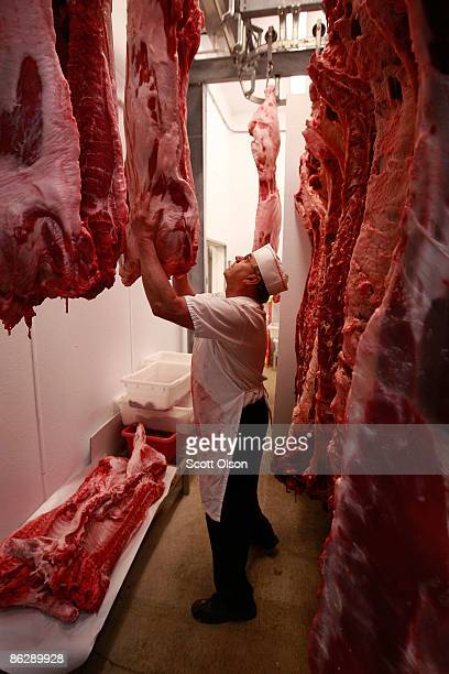 Dean Folkers selects a pig from the cooler to process for a customer at the Elma Locker and Grocery April 29 2009 in Elma Iowa Hog farmers who have...