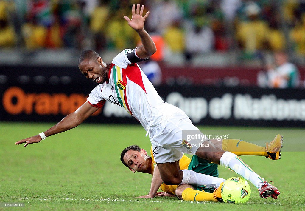 Dean Furman of South Africa tackles Seydou Keita of Mali during the 2013 African Cup of Nations Quarter-Final match between South Africa and Mali at Moses Mahbida Stadium on February 02, 2013 in Durban, South Africa.