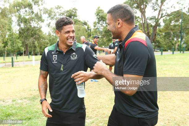 Dean Gagai reacts to Justin Hodges during a NRL Indigenous teams welcome ceremony at Yarra Park by the Scarred Tree on February 11 2019 in Melbourne...