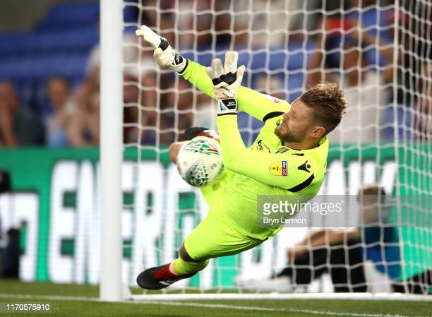 Dean Gerken of Colchester United saves a penalty from Andros Townsend of Crystal Palace in the shootout during the Carabao Cup Second Round match...