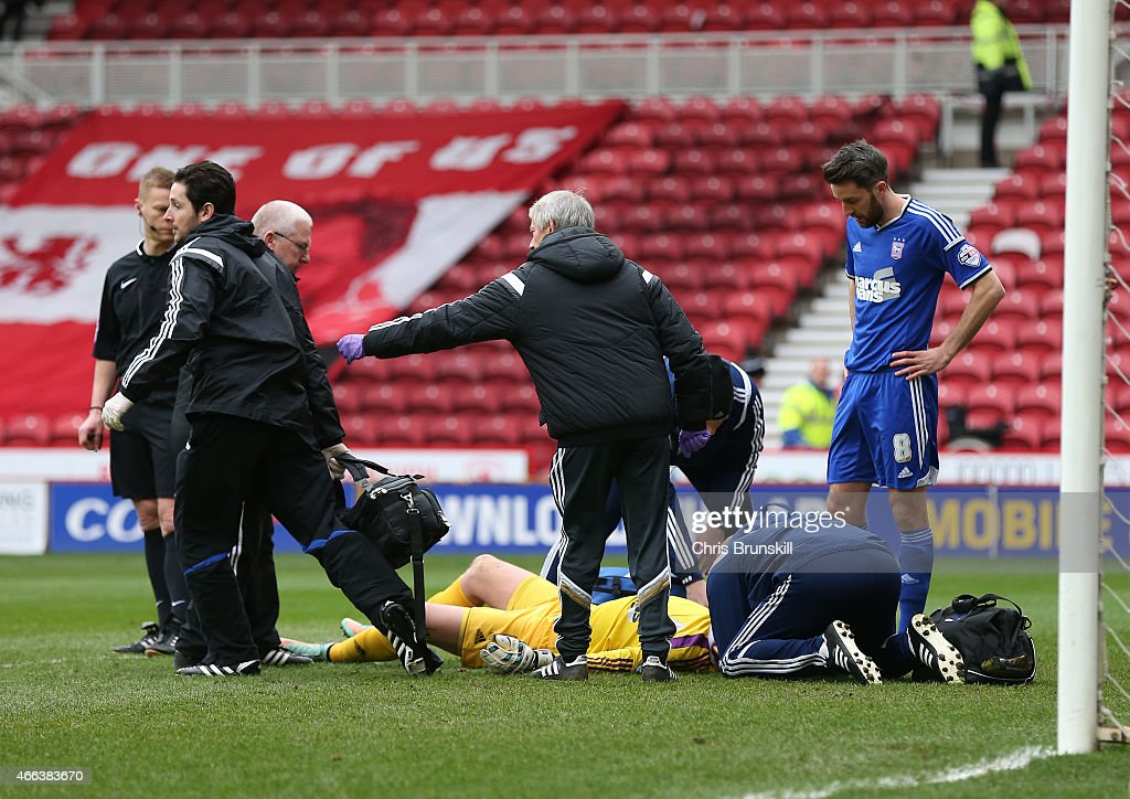 Dean Gerken of Ipswich Town receives treatment during the Sky Bet Championship match between Middlesbrough and Ipswich Town at the Riverside Stadium on March 14, 2015 in Middlesbrough, England.