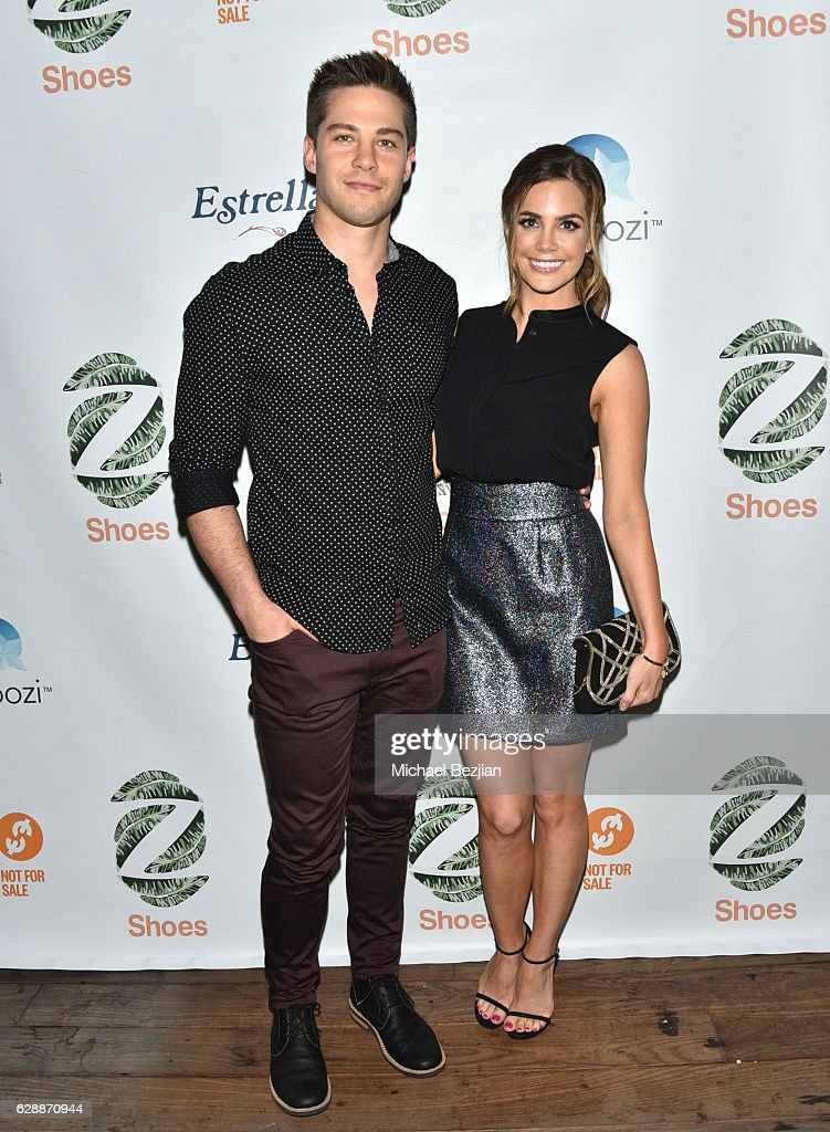 Dean Geyer (L) and actress Jillian Murray arrive at Not For Sale x Z Shoes Benefit at Estrella Sunset on December 9, 2016 in West Hollywood, California.