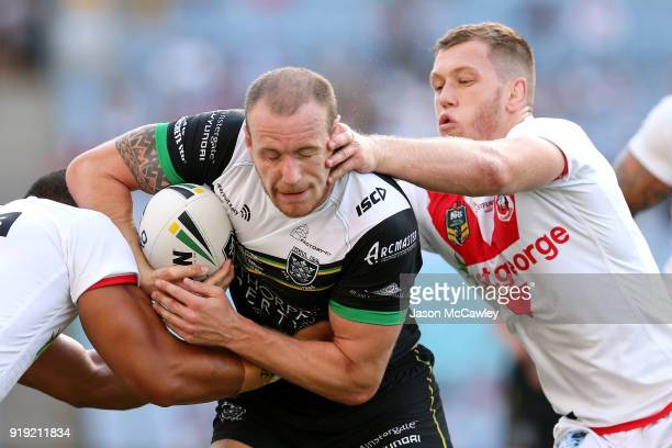 Dean Hadley of Hull is tackled during the NRL trial match between the St George Illawarra Dragons and Hull at ANZ Stadium on February 17, 2018 in...