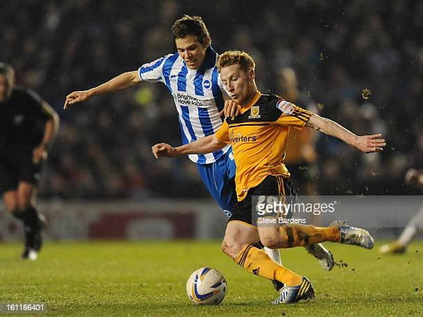 Dean Hammond of Brighton Hove Albion challenges for the ball with Stephen Quinn of Hull City during the npower Championship match between Brighton...