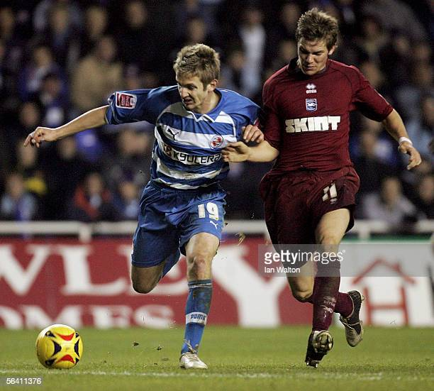Dean Hammond of Brighton Hove Albion tries to tackle Kevin Doyle during the Coca Cola Championship match between Reading and Brighton Hove Albion at...
