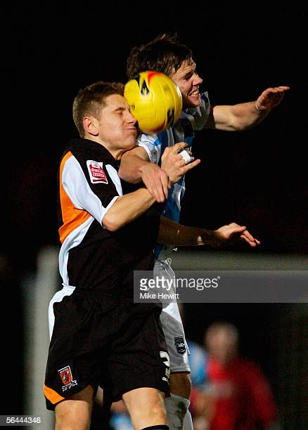 Dean Hammond of Brightonchallenges Andy Dawson of Hull during the CocaCola Championship match between Brighton Hove Albion and Hull City at the...